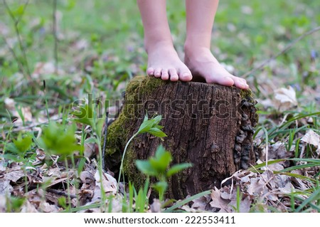 Close up of bare feet running on a trail in the forest. - stock photo