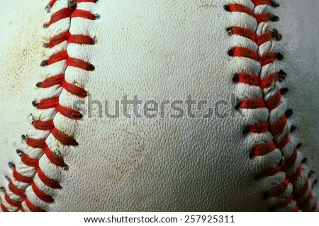 Close-up of baseball with red seams - stock photo