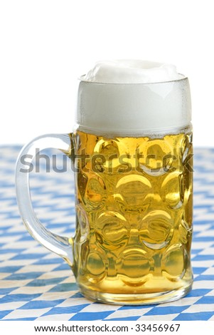 Close-up of bavarian beer in Beer stein at the Octoberfest - stock photo