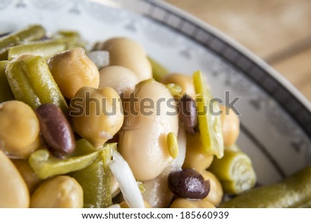 Close up of beans salad with onion on wood background