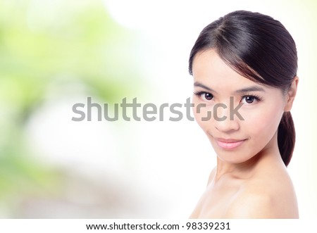 Close up of beautiful asian woman face with green background, model is a asian beauty - stock photo
