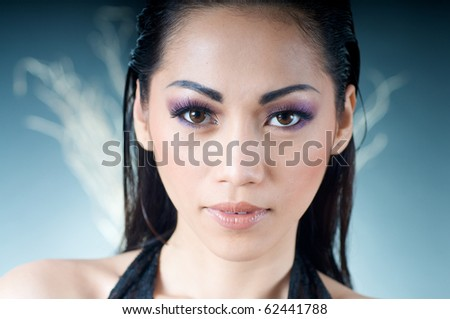 Close up of beautiful Asian woman in black dress - stock photo