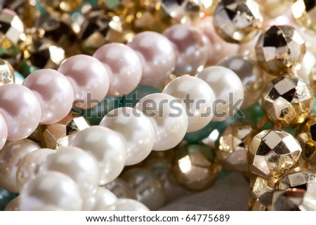 Close up of beautiful blue and pink pearls. - stock photo