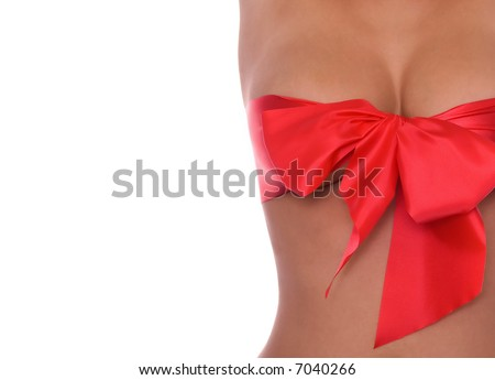 Close  up  of beautiful breasts with red ribbon - stock photo