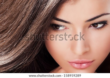 close up of beautiful brown eyes brunette young woman  - stock photo