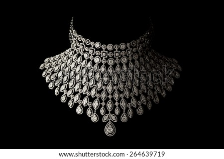 Close up of beautiful diamond necklace on black background - stock photo