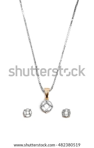 Close up of beautiful Diamond necklace with earrings isolated on white background.