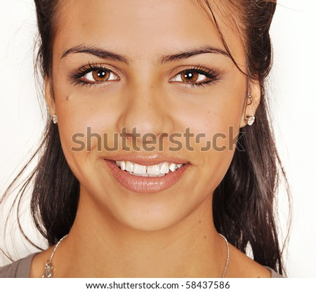 Close-up of beautiful face of young woman - stock photo