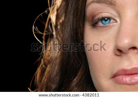 Close up of beautiful girl against black background - stock photo