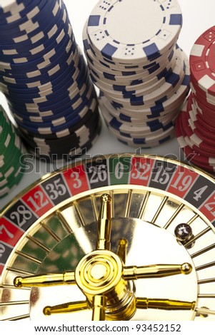 Close-up of beautiful gold roulette with chips on a white background.