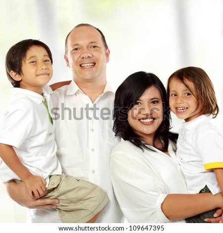 close up of Beautiful happy family together - stock photo