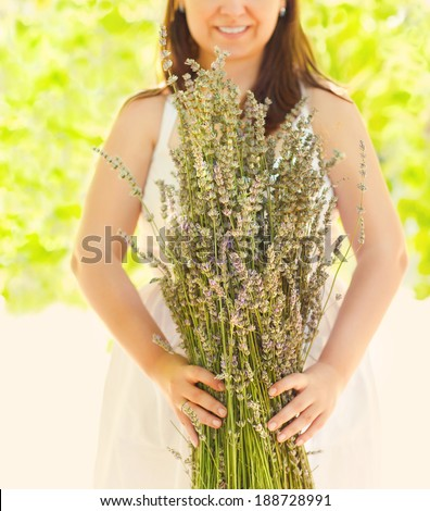 Close up of beautiful romantic woman with lavender bouquet - stock photo