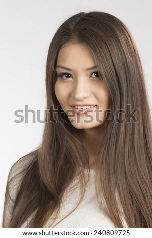 close up of beautiful sexy head shot of asian girl. studio shot. - stock photo