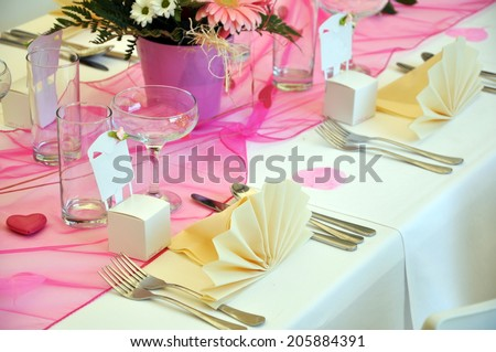 close up of beautiful wedding table with decoration - stock photo
