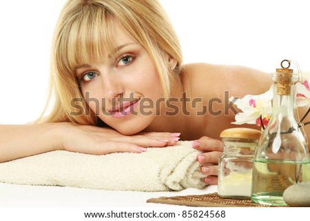 Close-up of beautiful woman ar spa salon isolated