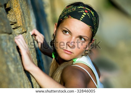 Close-up of beautiful woman holding the rock - stock photo