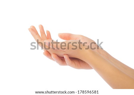 Close up of beautiful woman's hand, palm up. Isolated on white background - stock photo