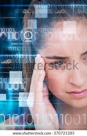 Close-up of beautiful woman suffering from headache against blue technology design with binary code - stock photo
