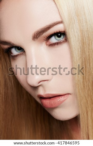 Close up of beautiful woman with natural makeup. Perfect skin texture. Blonde hair.