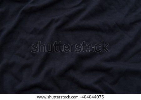 Close up of beautiful wrinkle black fabric texture. - stock photo