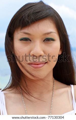 Close-Up of Beautiful Young Asian Girl on the Beach