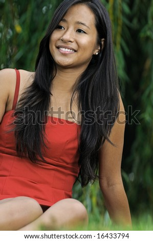 Close up of beautiful young Asian woman - sitting