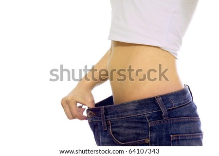 close-up of beautiful young female's body in old jeans - stock photo