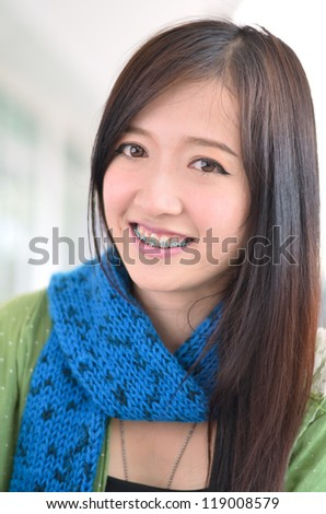 Close up of Beautiful young student,smile and showing braces