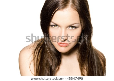 Close-up of beautiful young woman face. Isolated on white background.