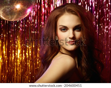 Close-up Of Beautiful Young Woman In Front Of Disco Ball