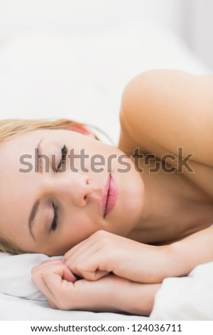 Close-up of beautiful young woman sleeping in bed at home
