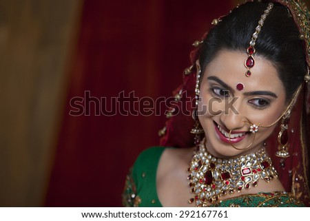 Close up of beautiful young woman smiling while looking away - stock photo