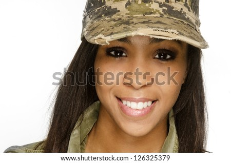 Close up of beautiful young woman wearing military hat army girl smiling. - stock photo