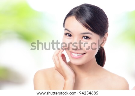 close up of Beauty woman Face and hand touch her face with green background for skin care concept, model is a beautiful asian girl - stock photo