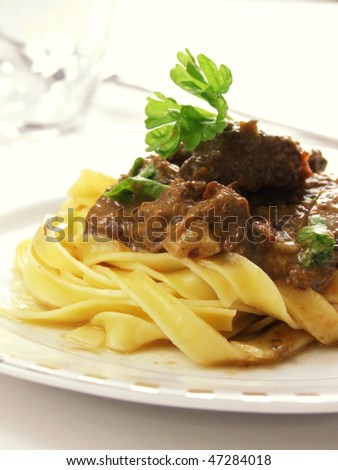 close-up of beef stroganoff on the white plate - stock photo