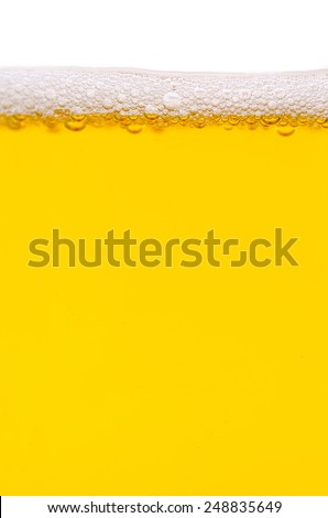 Close-up of beer and foam - stock photo
