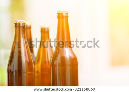 Close up of beer bottles, cold refreshment - stock photo