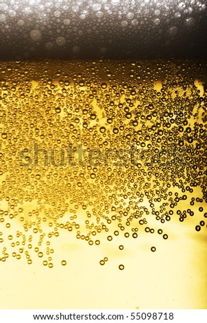 Close up of beer bubbles - stock photo