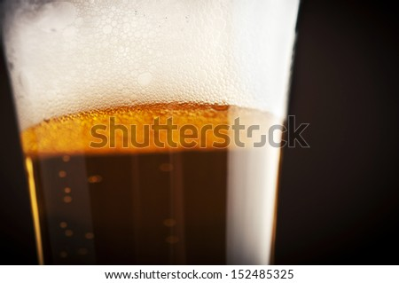 close up of beer bubbles on glass