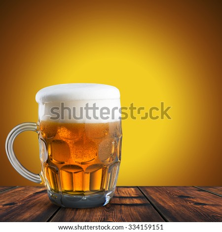 Close Up of Beer On Wood Table. Cold Refreshment