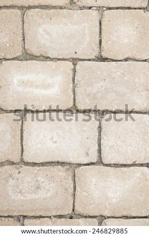 Close-up of beige paving stones - stock photo