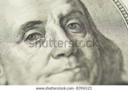 Close-up of Benjamin Franklin, one hundred dollars note. Shallow dof, focus on eyes. - stock photo