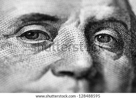 close up of Benjamin Franklin stare on one hundred dollars banknote - stock photo