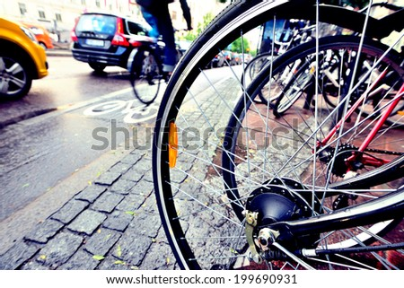 Close up of bicycle, bike and bike lane in background - stock photo
