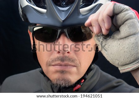 Close-up of bicycle courier tipping his helmet. - stock photo