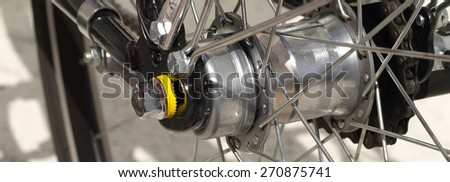 Close-up of bicycle tire with spokes, panorama - stock photo