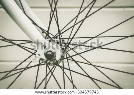 close up of bicycle wheels process in vintage retro style