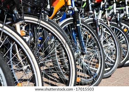 Close-up of bicycles in a row. Shallow DOF. - stock photo
