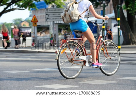 Close up of bike and bicyclist - stock photo
