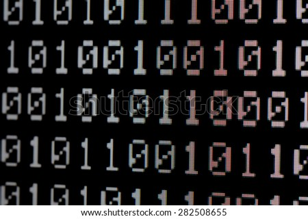 Close up of Binary number pixels on LED TV monitor - stock photo